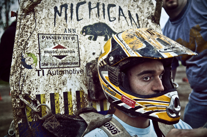 Baja Racer with muddy helmet